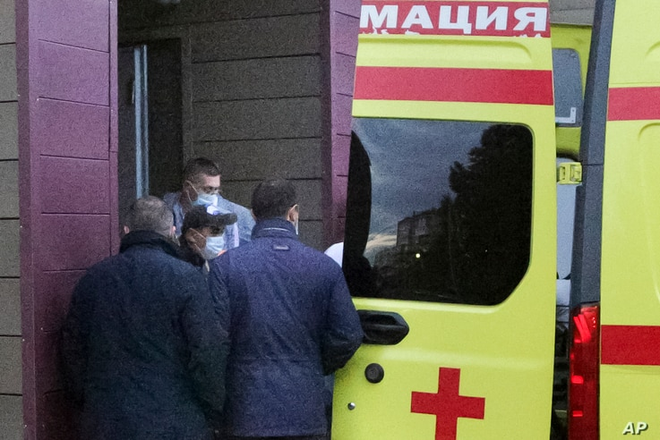 Russian dissident Alexei Navalny, not seen in photo, on a stretcher is transferred into an ambulance before being driven to an airport, at the Omsk Ambulance Hospital, in Omsk, Russia, Aug. 22, 2020.