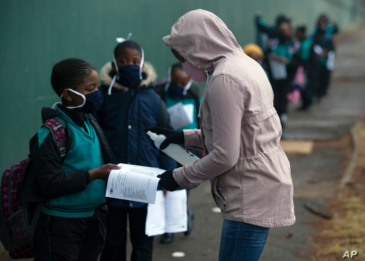 Students go through the regular morning checks on their arrival at the Melpark Primary School in Johannesburg, South Africa, Sept. 3, 2020.