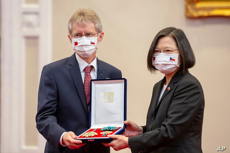 In this photo released by the Taiwan Presidential Office, the Czech Senate President Milos Vystrcil is presented a medal by Taiwanese President Tsai Ing-wen during a meeting in Taipei, Taiwan, Sept. 3, 2020.
