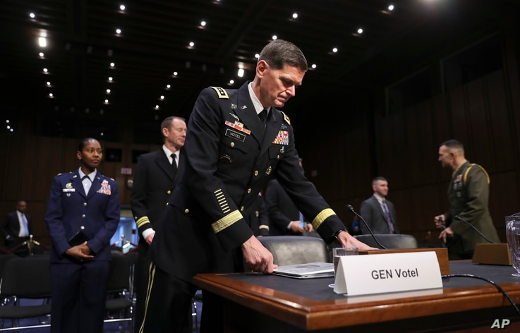 FILE - Gen. Jospeh Votel, then commander of the U.S. Central Command, arrives to testify before the Senate Committee on Armed Services, on Capitol Hill, in Washington, March 13, 2018.