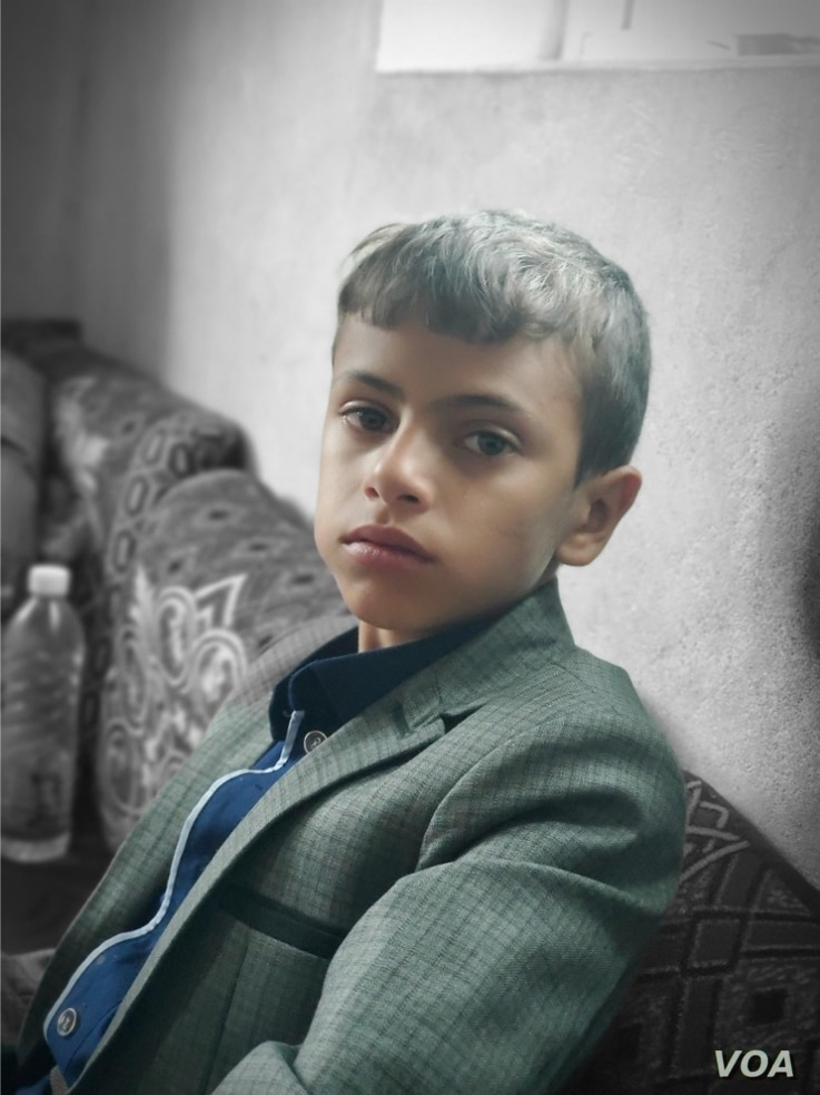 Mazen Mohia Aldeen, 8, says he will drop out of school if another airstrike hits a school in his neighborhood, pictured on Aug. 25, 2020, in Sana'a, Yemen. (VOA)