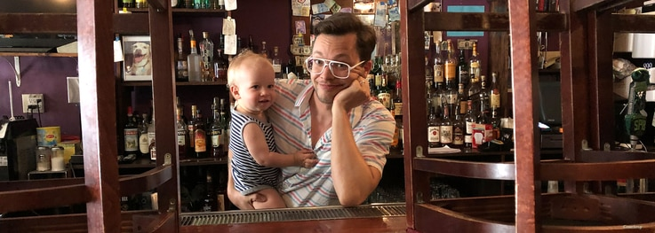 T. Cole Newton with his child at his bar. Newton began hosting presidential debate watch parties at his New Orleans, Louisiana bar in 2012. (Courtesy/Twelve Mile Limit)
