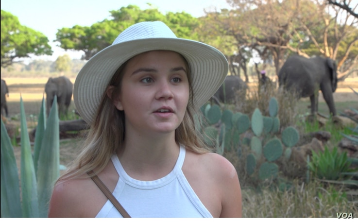 South African tourist Phillipa Meek says she decided to visit the Wild is Life center in Harare after seeing the video online, Sept. 23, 2020. (Columbus Mavhunga/VOA)