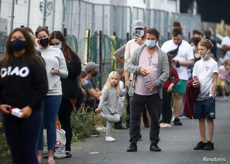 People queue at a testing site amid the coronavirus pandemic in Southend-on-Sea, Britain, Sept. 16, 2020.