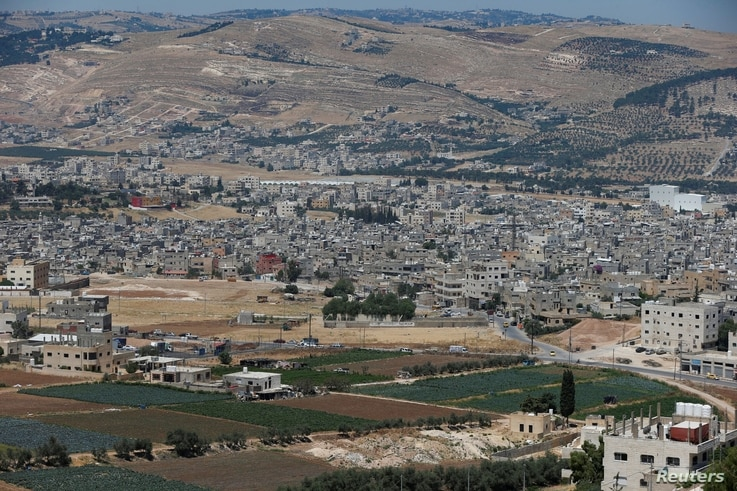 FILE - A general view shows the Al-Baqaa Palestinian refugee camp, near Amman, Jordan, June 16, 2020.