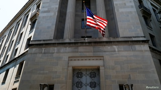 The U.S. Department of Justice headquarters building is seen after Deputy U.S. Attorney General Rod Rosenstein announced grand...
