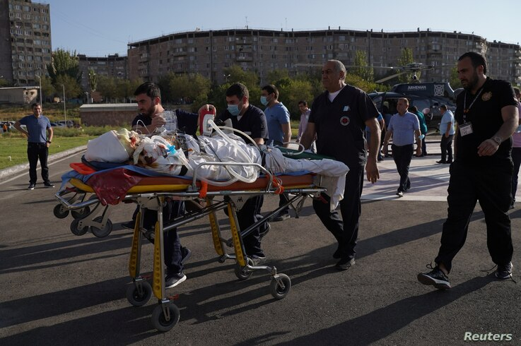 An ethnic Armenian soldier, who was wounded in fighting with Azeri forces over the breakaway region of Nagorno-Karabakh, is carried on a stretcher to Erebouni Medical Center in Yerevan, Armenia, Sept. 29, 2020.