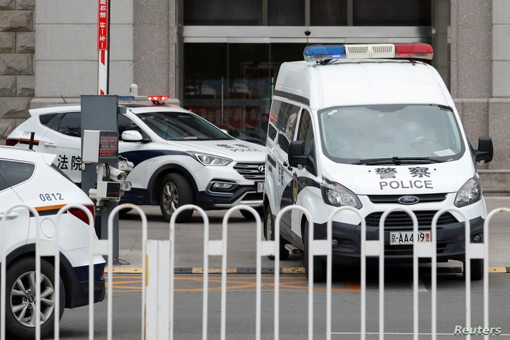 An escorted police van believed to be carrying Huayuan Real Estate Group former chairman Ren Zhiqiang leaves Beijing No. 2 Intermediate People's Court, where Ren faces corruption trial, in Beijing, China, Sept. 11, 2020.