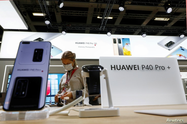 A visitor is seen at a Huawei P40 Pro+ stand at the IFA consumer technology fair in Berlin, Germany, Sept. 3, 2020.