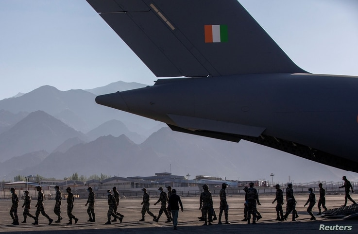 Indian soldiers disembark from a military transport plane at a forward airbase in Leh, in the Ladakh region, Sept. 15, 2020.