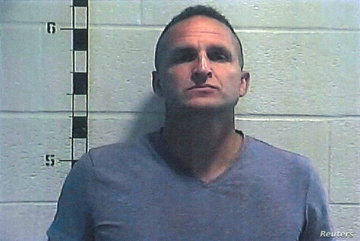 Former Louisville police detective Brett Hankison poses for a booking photograph at Shelby County Detention Center in Shelbyville, Kentucky, Sept. 23, 2020.