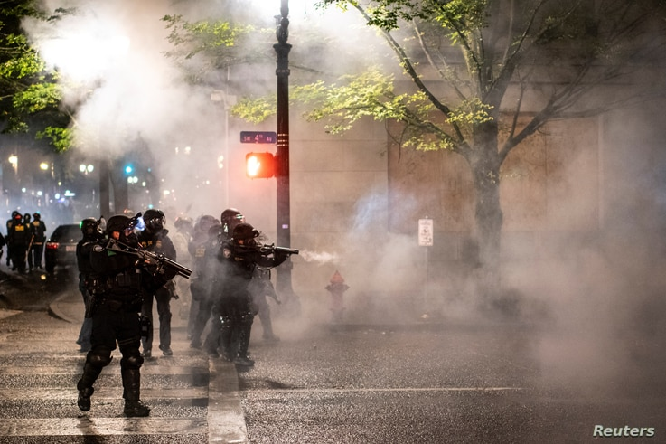 Federal law enforcement officers stand guard during unrest that followed the grand jury decision in Louisville's Breonna Taylor case, in Portland, Oregon, Sept. 23, 2020.