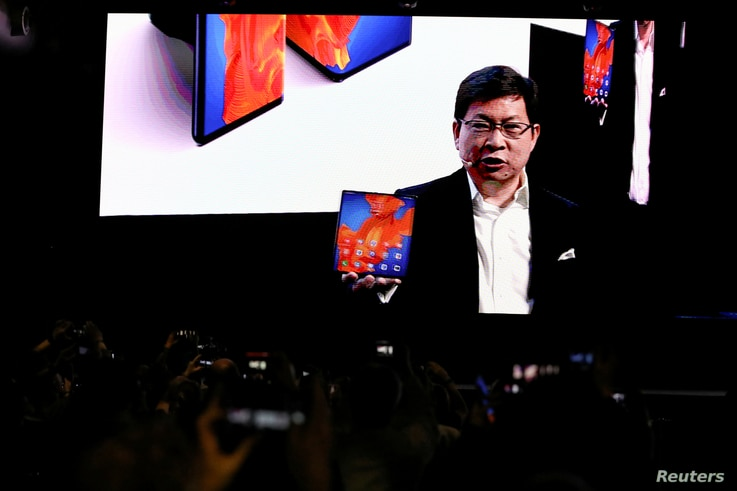 Richard Yu, CEO of Huawei Technologies Consumer Business Group, holds a Huawei Mate Xs foldable smartphone, as he talks to the audience during Huawei stream product launch event in Barcelona, Spain, Feb. 24, 2020.