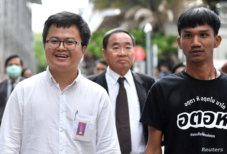 Anon Nampa and Panupong Jadnok, two of the leaders of recent anti-government protests, are seen after being granted a bail outside the criminal court in Bangkok, Thailand, Aug. 8, 2020.
