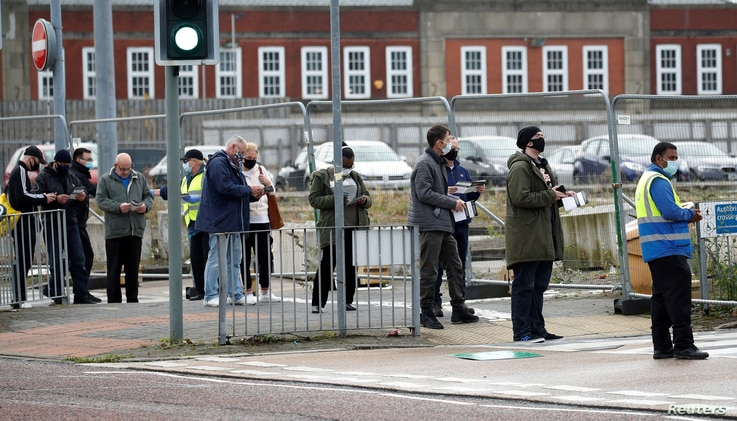 People queue to take a COVID-19 test at a walk-in test facility in Bolton, Britain, Sept. 7, 2020.