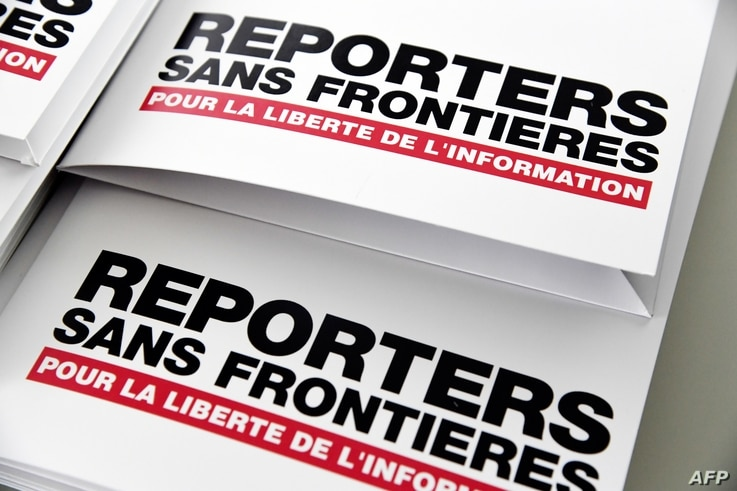 Press releases are pictured on April 25, 2018 in Paris during a press conference of Reporters Without Borders (RSF) to present…