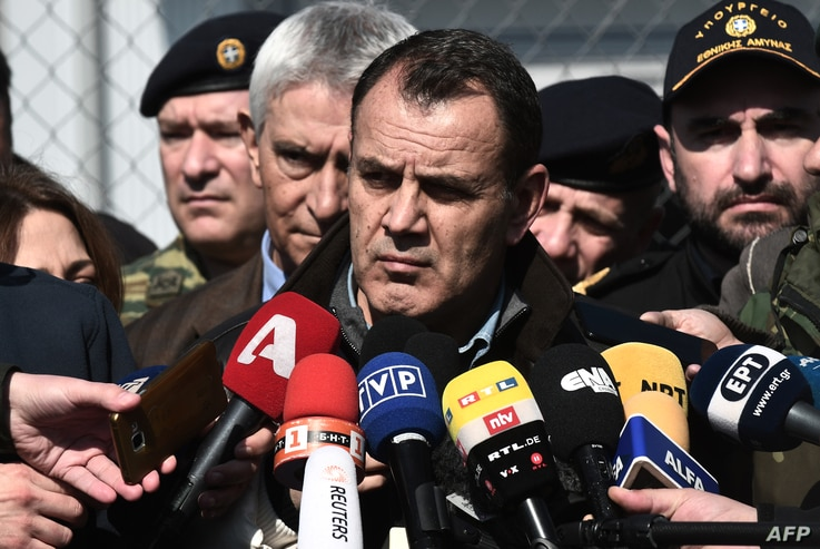Greek Minister of defence Nikos Panagiotopoulos speaks to journalists in Kastanies on March 1, 2020. - Thousands more migrants…