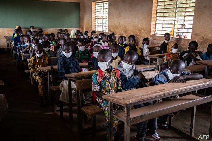 Children sit in their classroom on the first day of the new school year, in Ouagadougou, on October 1, 2020. (Photo by OLYMPIA…