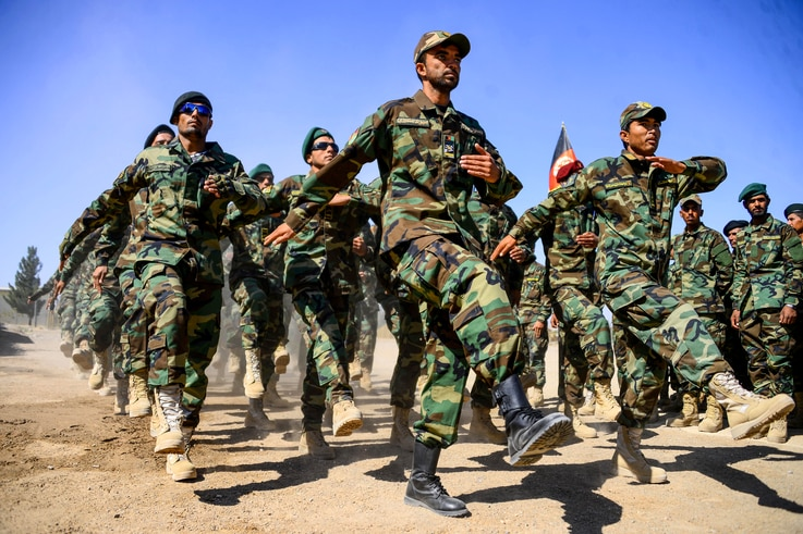 Afghan National Army (ANA) soldiers march during a ceremony at a military base in the Guzara district of Herat province on…