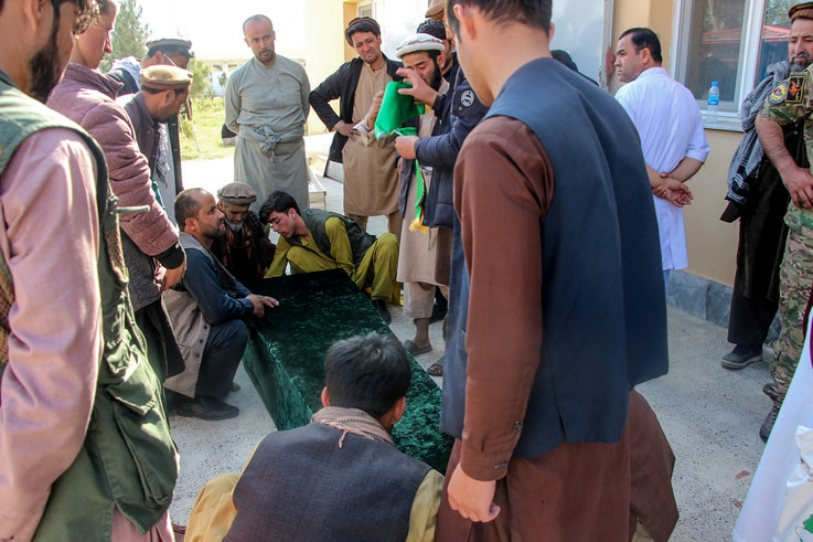 Relatives gather next to the coffin of a soldier outside a hospital after an ambush blamed on the Talibans killed at least 25…