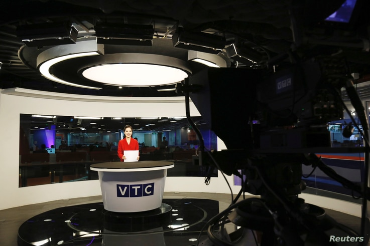 Vietnamese television anchor Hoang Phuong works in a studio of VTC Television during a news program in Hanoi, Vietmam May 2,…