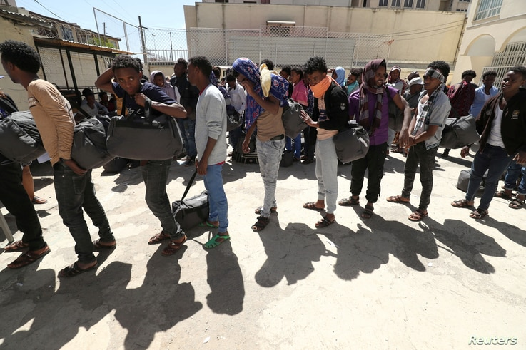 Ethiopian migrants wait to be registered at a International Organization for Migration (IOM) temporary shelter after being…