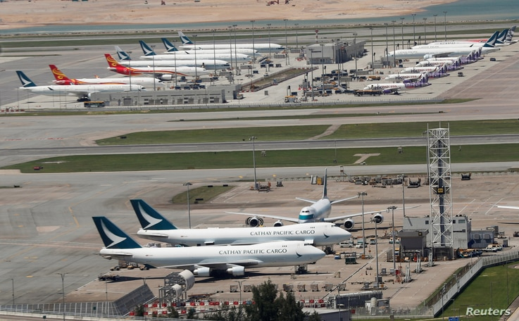 Cathay Pacific Airways and Dragon Airways planes are seen at the Hong Kong International Airport, China September 6, 2019…