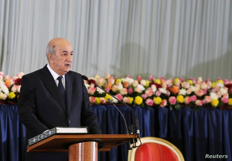 Newly elected Algerian President Abdelmadjid Tebboune takes the oath during a swearing-in ceremony in Algiers, Algeria December…