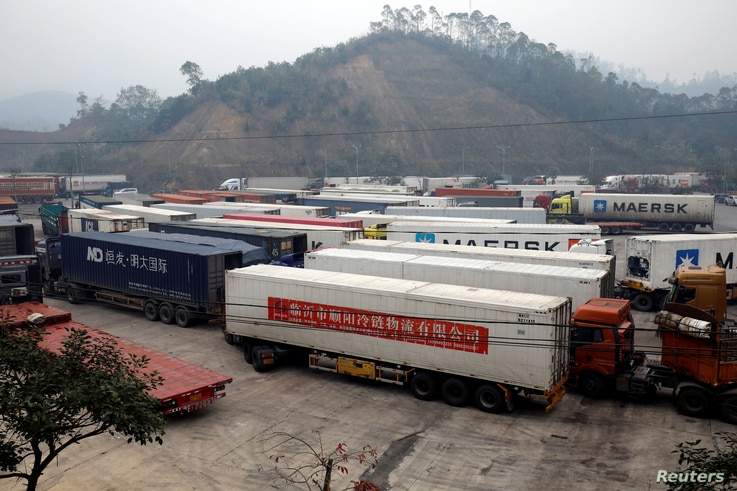 Container trucks are seen while waiting for cross the border at Huu Nghi border gate connecting with China, in Lang Son…