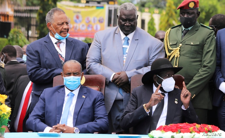 Sudan's Sovereign Council Chief General Abdel Fattah al-Burhan, and South Sudan's President Salva Kiir attend the signing of…
