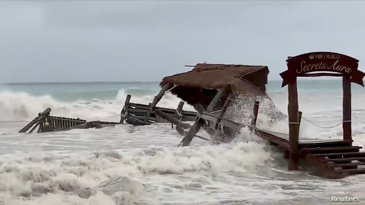 A pier is washed away by Tropical Storm Gamma in Cozumel, Mexico, October 3, 2020, in this still image from video obtained via…