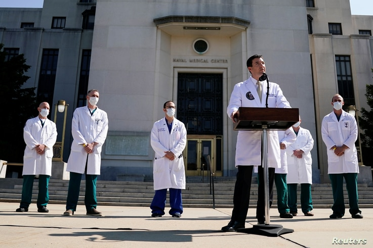 U.S. Navy Commander Dr. Sean Conley, the White House physician, is flanked by other doctors as he speaks to the media about U.S…