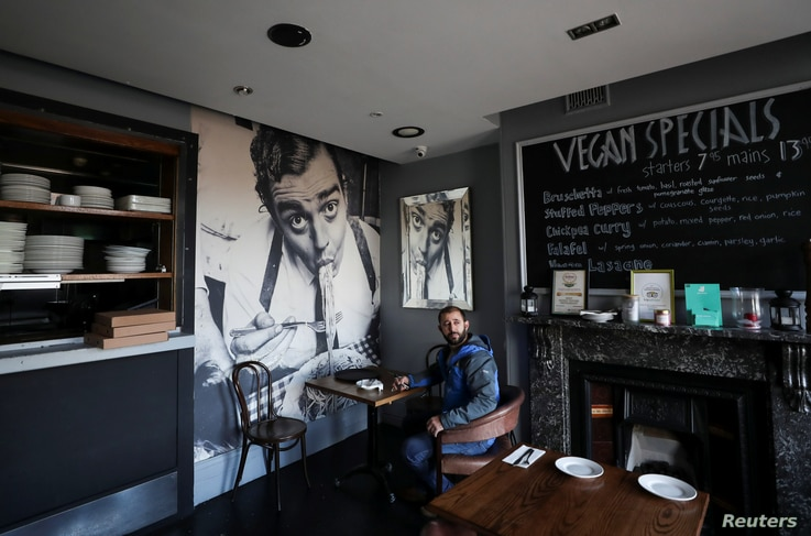Andreas Spahiu owner and manager of Don Vito?s restaurant is seen inside his premise, which is closing at the weekend due to…
