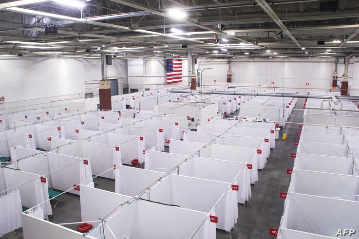 An overhead view shows a field hospital known as an Alternate Care Facility set up at the state fair ground as cases of…