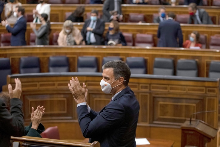 Spanish Prime Minister Pedro Sanchez applauds after a no confidence motion against the government at parliament in Madrid,…