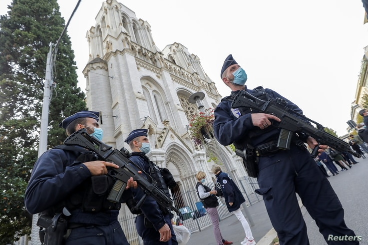 Police officers stand near Notre Dame church, where a knife attack took place, in Nice, France October 29, 2020. REUTERS/Eric…