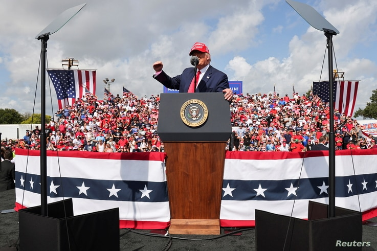 U.S. President Donald Trump gestures as he speaks during a campaign rally outside Raymond James Stadium, in Tampa, Florida.