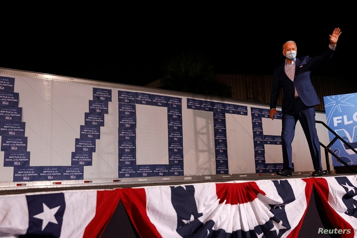 Democratic U.S. presidential nominee and former Vice President Joe Biden greets suporters at a drive-in, Get Out the Vote.