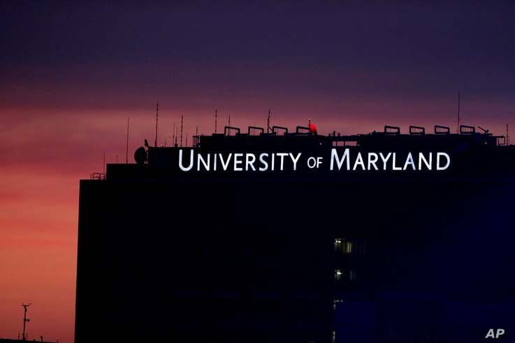 A building at the University of Maryland Baltimore campus is seen after sunset, Monday, Aug. 19, 2019, in Baltimore. (AP Photo…