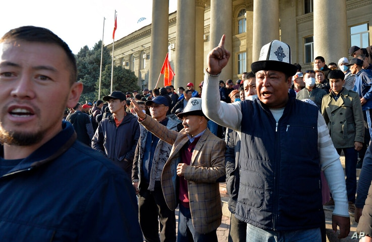 People protest during a rally on the central square in Bishkek, Kyrgyzstan, Wednesday, Oct. 7, 2020. Officials in Kyrgyzstan…