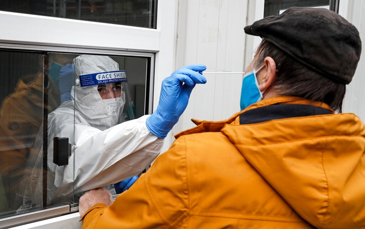 Medical staff takes a COVID-19 test at a coronavirus test center in Cologne, Germany, Thursday, Oct. 15, 2020. The city…
