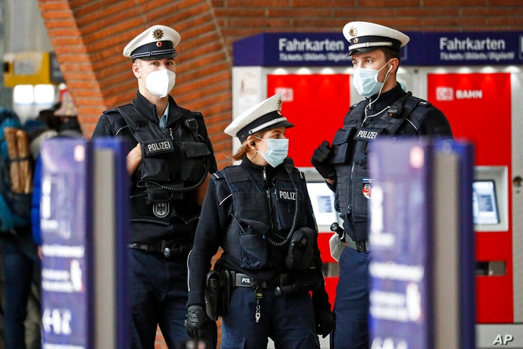 Police with face masks control the coronavirus orders at the train station in Cologne, Germany, Thursday, Oct. 15, 2020. The…