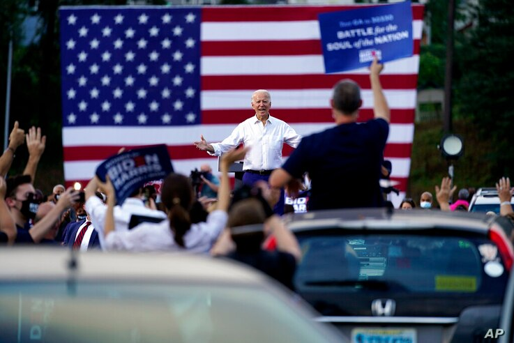 Democratic presidential candidate former Vice President Joe Biden greets supporters at a drive-in rally at Cellairis…