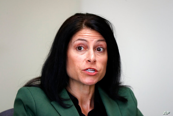 FILE - In this June 4, 2019, photo, Michigan Attorney General Dana Nessel listens to a question from reporters in Detroit…