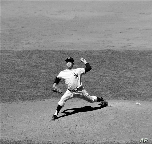 Whitey Ford of the New York Yankees as he pitched a five-hitter against the Chicago White Sox for his 13th victory of the year,…