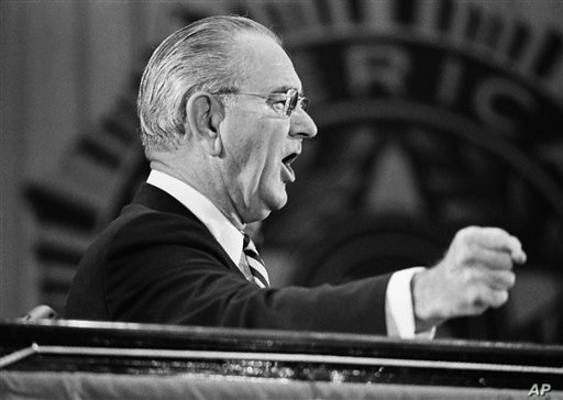 U.S. President Lyndon Johnson slams his fist on the podium for emphasis as he tells legionnaires on Tuesday, Sept. 11,1968 that…