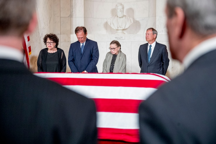 From left, Associate Justices Sonia Sotomayor, Samuel Alito, Ruth Bader Ginsburg, and Chief Justice John Roberts as the late Supreme Court Justice John Paul Stevens lies in repose at the Supreme Court, July 22, 2019.