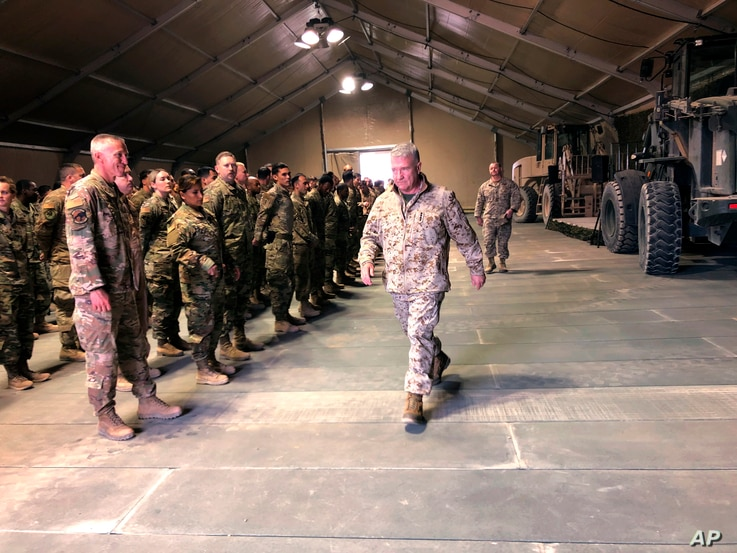 Marine Gen. Frank McKenzie, the top U.S. commander for the Middle East, meets with troops at Prince Sultan Air Base in Saudi…