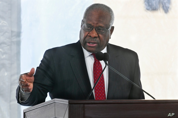 FILE - In this Feb. 11, 2020, file photo, Supreme Court Justice Clarence Thomas delivers a keynote speech during a dedication…
