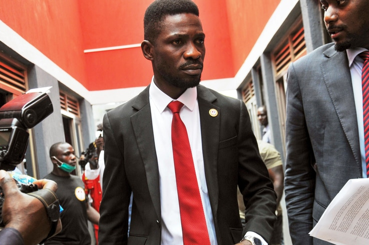 Bobi Wine, center, a singer and lawmaker whose real name is Kyagulanyi Ssentamu, arrives to speak at the National Unity…